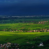 Thundery weather befor the storm over the green valley in Alsace, aerial view, vivid colors