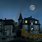 Mysterious abandoned house with full Lune on night sky, infrared view