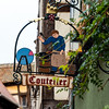 Old art signboards over shops in Ribeauville in Alsace