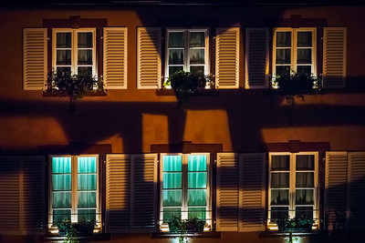Highlighted windows in old house night view
