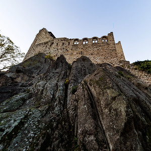 Old medieval hilltop castle Bernstein in Alsace. The ruins of a historic fort are built on a cliff.