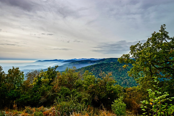 Beautiful mountains landscape from the top of the hill with fog