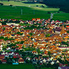 Little alsacien village Scherwiller in green vineyards, aerial view, summer time