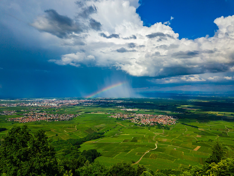 Aerial panoramic view of the rainbow over the green valley