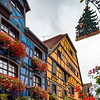 The fabulous Alsatian town of Ribeauville in the fall. Flowers on the windows and colorful houses