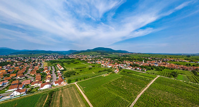 Perspective aerial view from drone to fields and meadows of Alsace