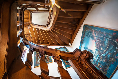 Wooden spiral staircase in old house