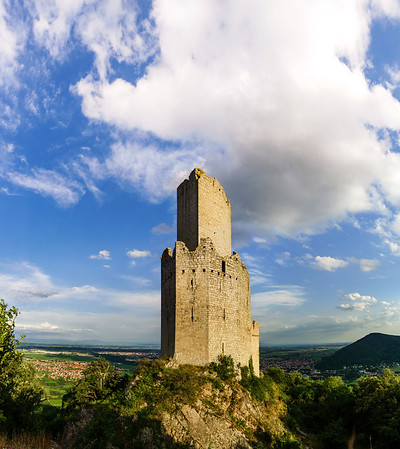 Majestic medieval castle ruins on the top of the hill