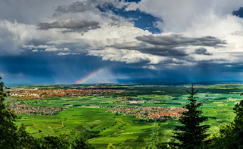 Aerial panoramic view of the rainbow over the green valley, drone shooting