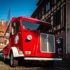 Editorial: 3th August 2018, Barr, France. Vivid red retro minivan Citroen on the street