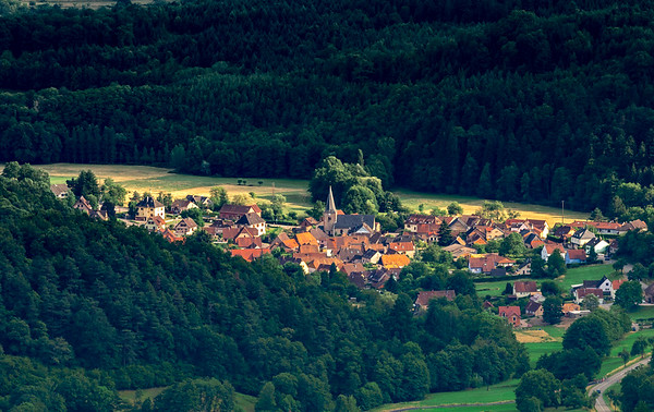 Spacious mountain landscape. A view from the mountain to the valley of Rhine and the village of Alsace.