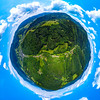 Little planet view of Vosges mountains in Alsace, green earth with blue sky