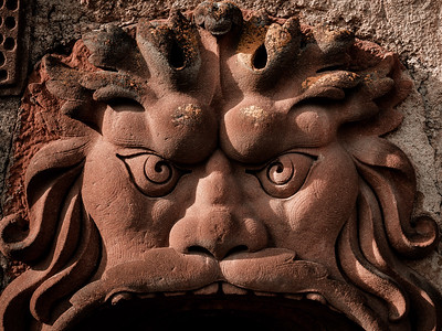 The loophole of the old castle, depicting the head of a terrible monster