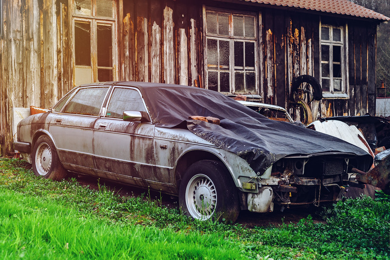 Abandoned old rusty body and parts of retro car