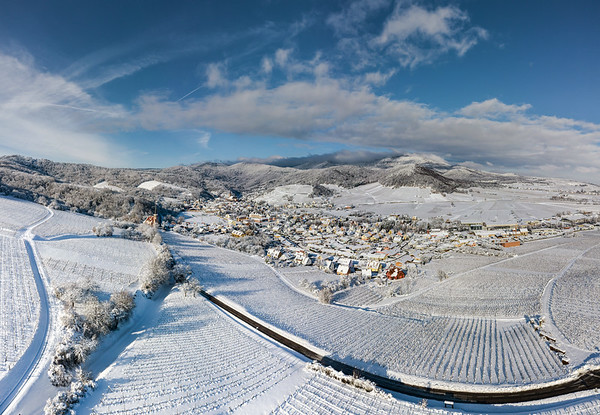 Snow-covered hills of Alsace, vineyards and the foothills of the Vosges.