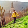Cute little girl in vineyards, spring sunny day