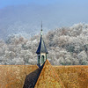 Church and frozen trees in little french village