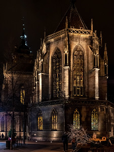 View of the cathedral in Colmar at night. The magnificent building is very beautifully illuminated.