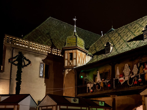 Christmas decorations on the streets of Colmar. Illuminated houses and New Year's fairy tale