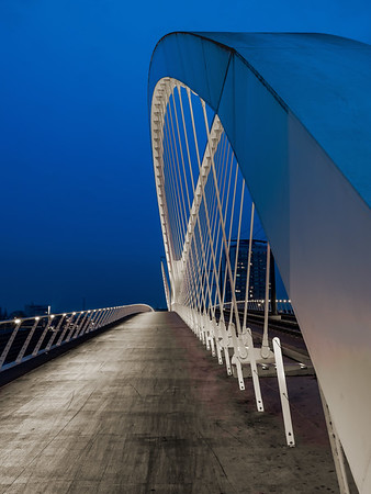 Lighted bridge between France and Germany at night. Pedestrian walkway and tram line. Pont de l'Europe