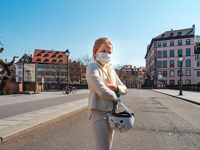 Girl on a bicycle in the empty city of Strasbourg