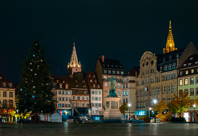 Central place Kleber in Strasbourg.  Decorating of the huge christmas tree. Hi resolution night panoramic view.