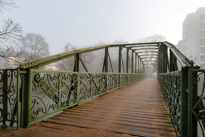 Beautiful pedestrian bridge in Strasbourg, foggy weather