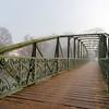 Beautiful pedestrian bridge in Strasbourg, foggy weather