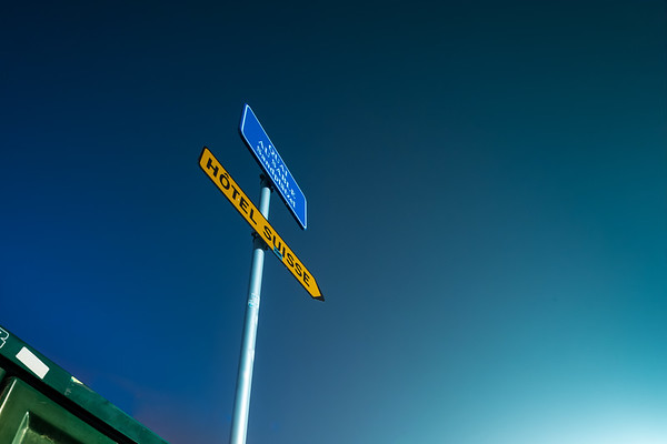 Minimalistic composition. Road sign on night sky background