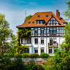 Beautiful traditional timber-framing alsacien house panoramic view, vivid colors of spring, Strasbourg, France