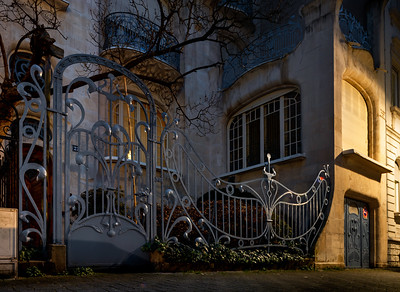 A chic Art Nouveau house with a beautiful wrought-iron grille and elegant curves of architectural forms
