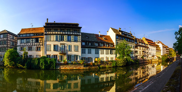 Old center of Strasbourg. Typical alsacien houses on the river. Vivid colors on sunset.