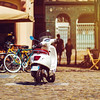 Sunny holidays in old city, Vespa scooter on the street