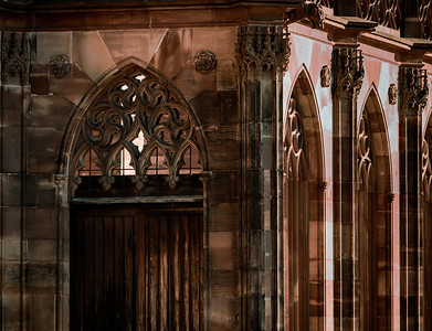 Tall and geometric forms of the portals of the Gothic cathedral of Strasbourg. Abstract photographs of architecture details.