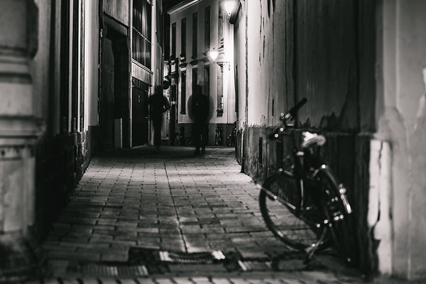 Empty lonely street with parked bikes at night, Strasbourg