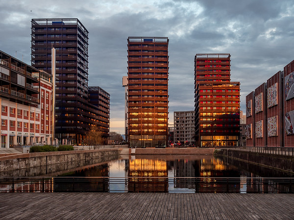 Evening Strasbourg. Orange sunset against the background of the library and new high-rise buildings.