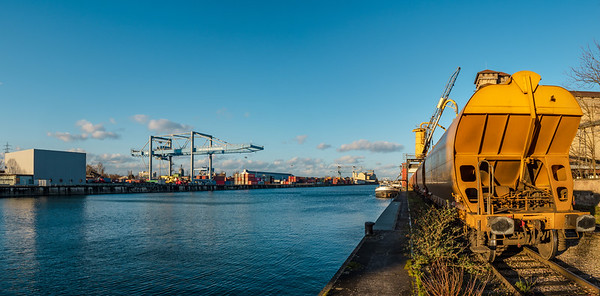 Cargo port of Strasbourg. Containers, ships and railroad cars.