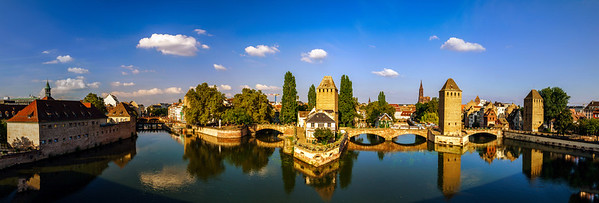 Old historical center of Strasbourg. Fortress towers and briges in Little France with reflection in the river.