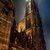 Stunning bottom view of Strasbourg Cathedral illuminated at night, Europe's tallest building.