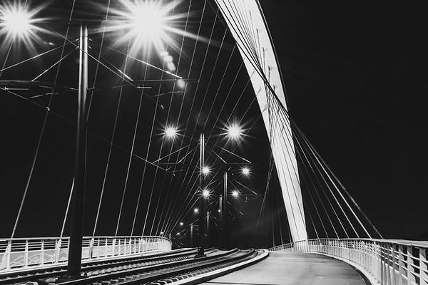 Citadelle Bridge across Bassin Vauban for trams and bicycles. Night view.