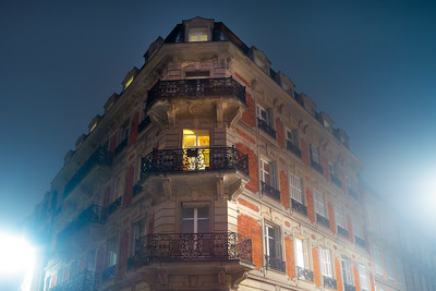 Chic rich building in Strasbourg, perspective view. Fog, night.