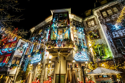 Strasbourg, France - November 24, 2018:   Traditional Christmas market with handmade souvenirs and highlighted streets