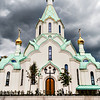 New Russian Orthodox Church in Strasbourg. Thunderclouds and a tent-roofed bell tower directed upwards