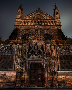 The side facade of the Cathedral in Strasbourg, richly decorated with sculptural compositions