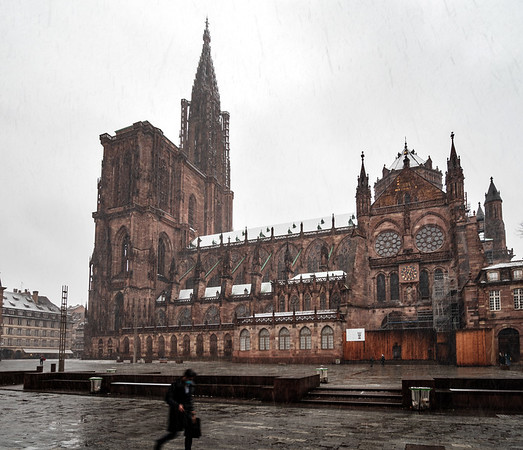 First snow in Strasbourg. The snow is falling and melting, the weather is wet.