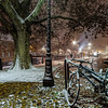Snow-covered bicycles on the street, Strasbourg, night view, Christmas time