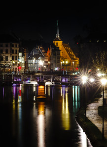 Saint Nicolas church in Strasbourg night view with reflections in the river Ill