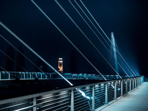 Lighted footbridge between France and Germany at night. Strasbourg. Passerelle des Deux Rives