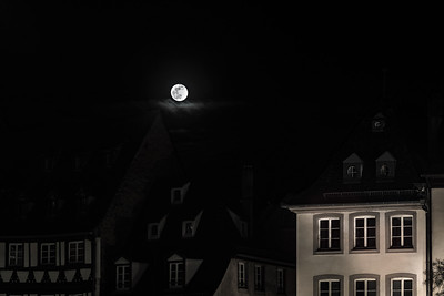 Full moon over the old roofs of historical center, Strasbourg