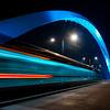 Lighted tram bridge at night. Strasbourg. Moving tram. Passerelle de la Citadelle